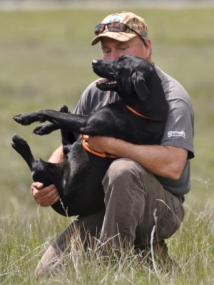 Labs-R-It Labrador Retriever Breeding and Training Randy holding Hope